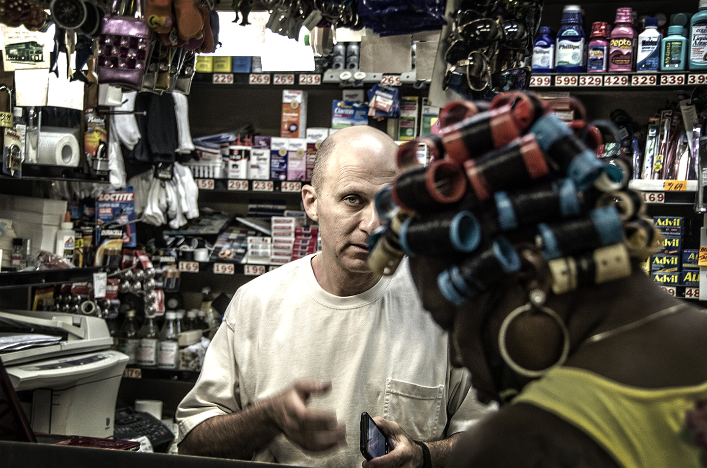Mike Keller waits on a customer at his store, the Keller Market Food Store.