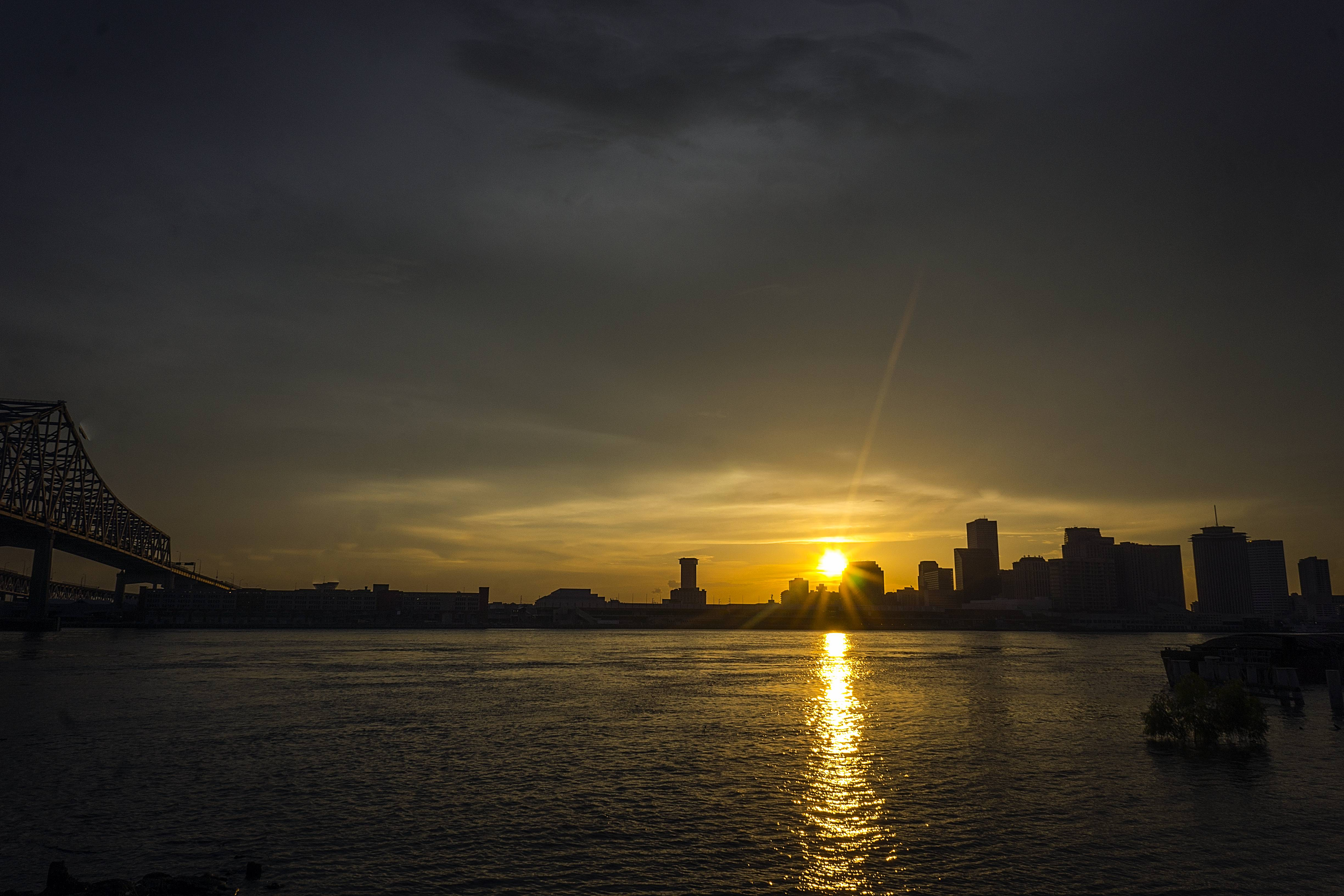 The New Orleans Skyline and The Crescent City Connection photographed from Algiers at sunset.