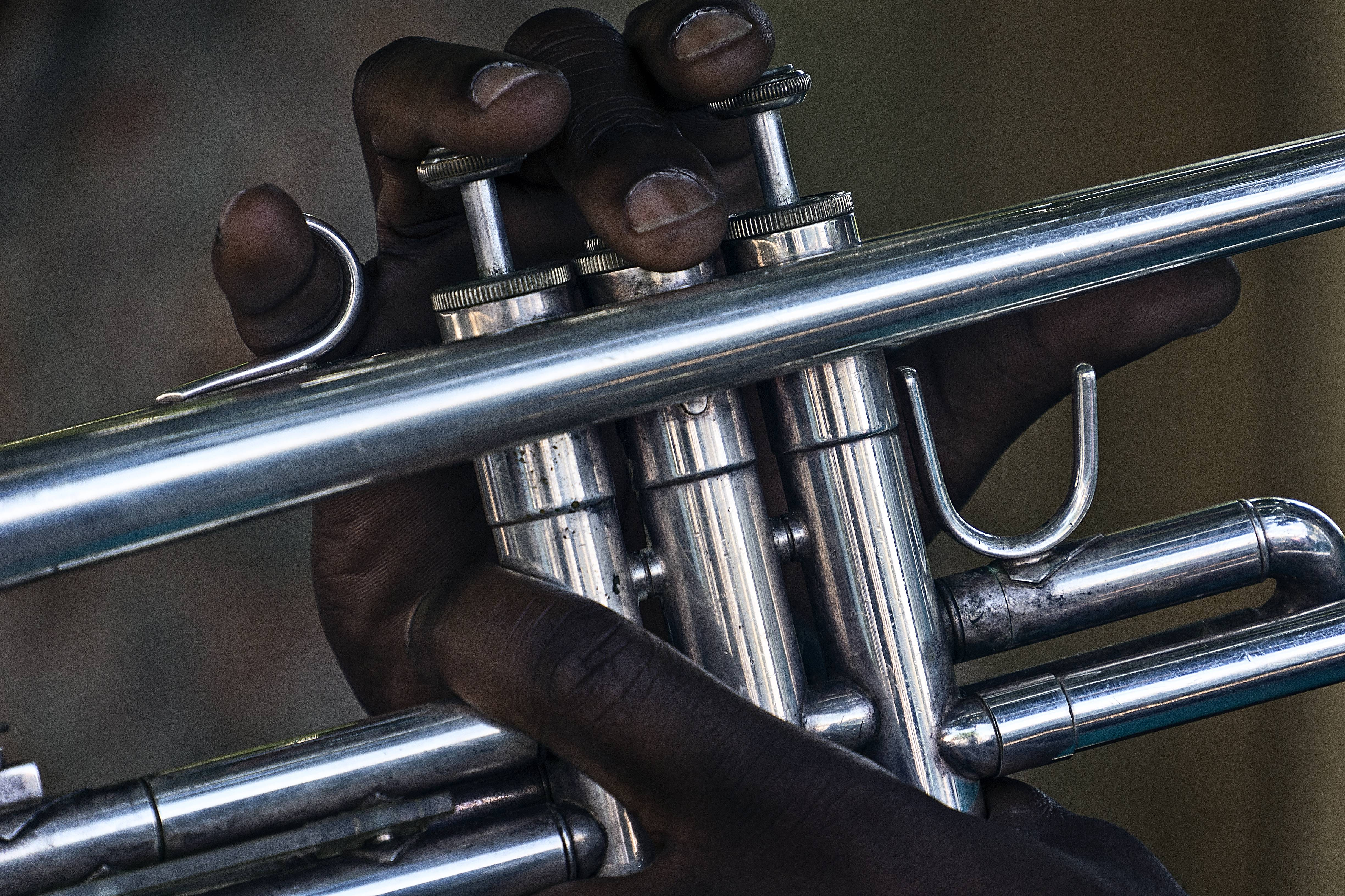A very tight image of a musician's hand