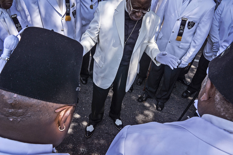 Reverend leads parade walkers in prayer.