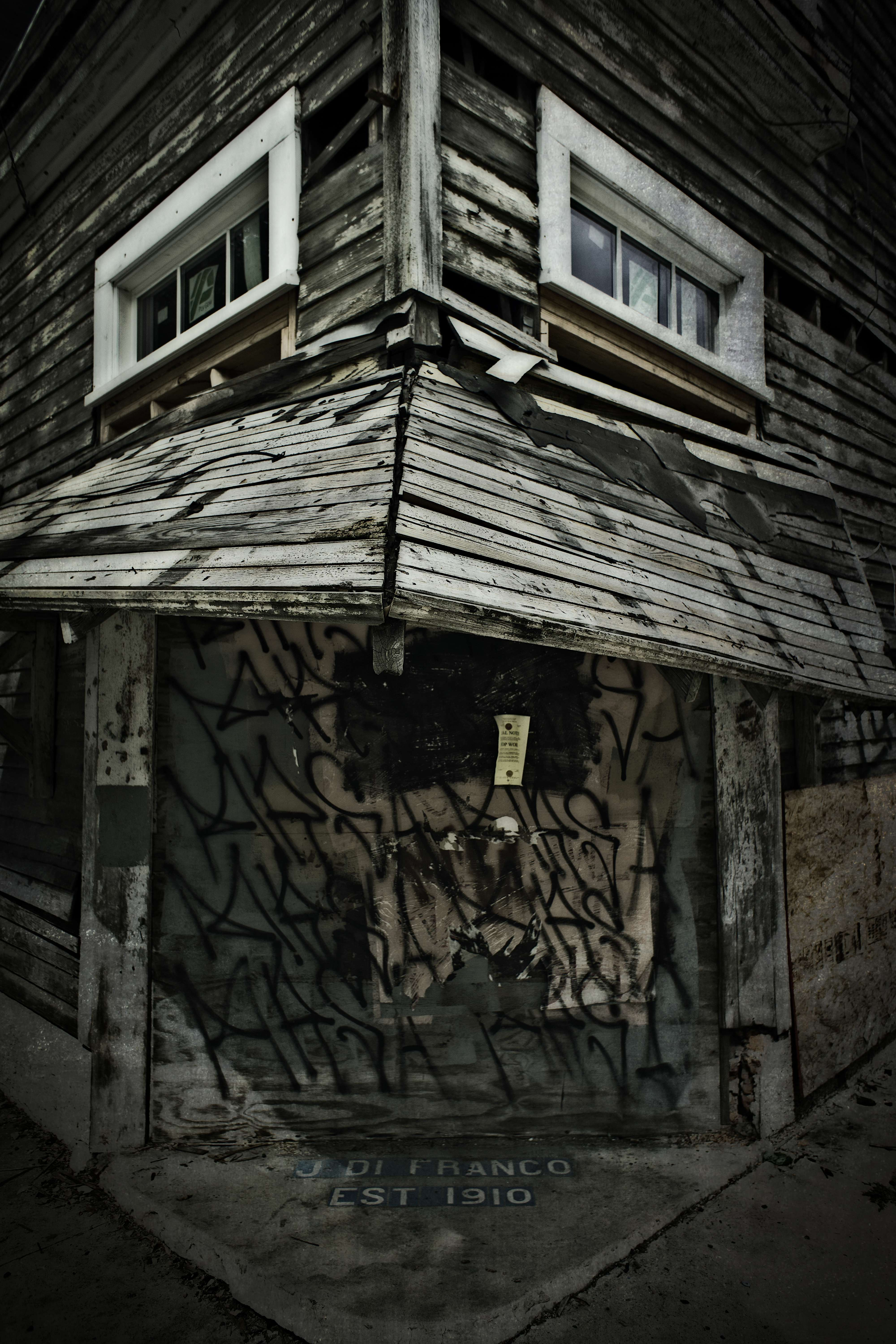 Once, there was a corner store. Now, there is a boarded up old building.