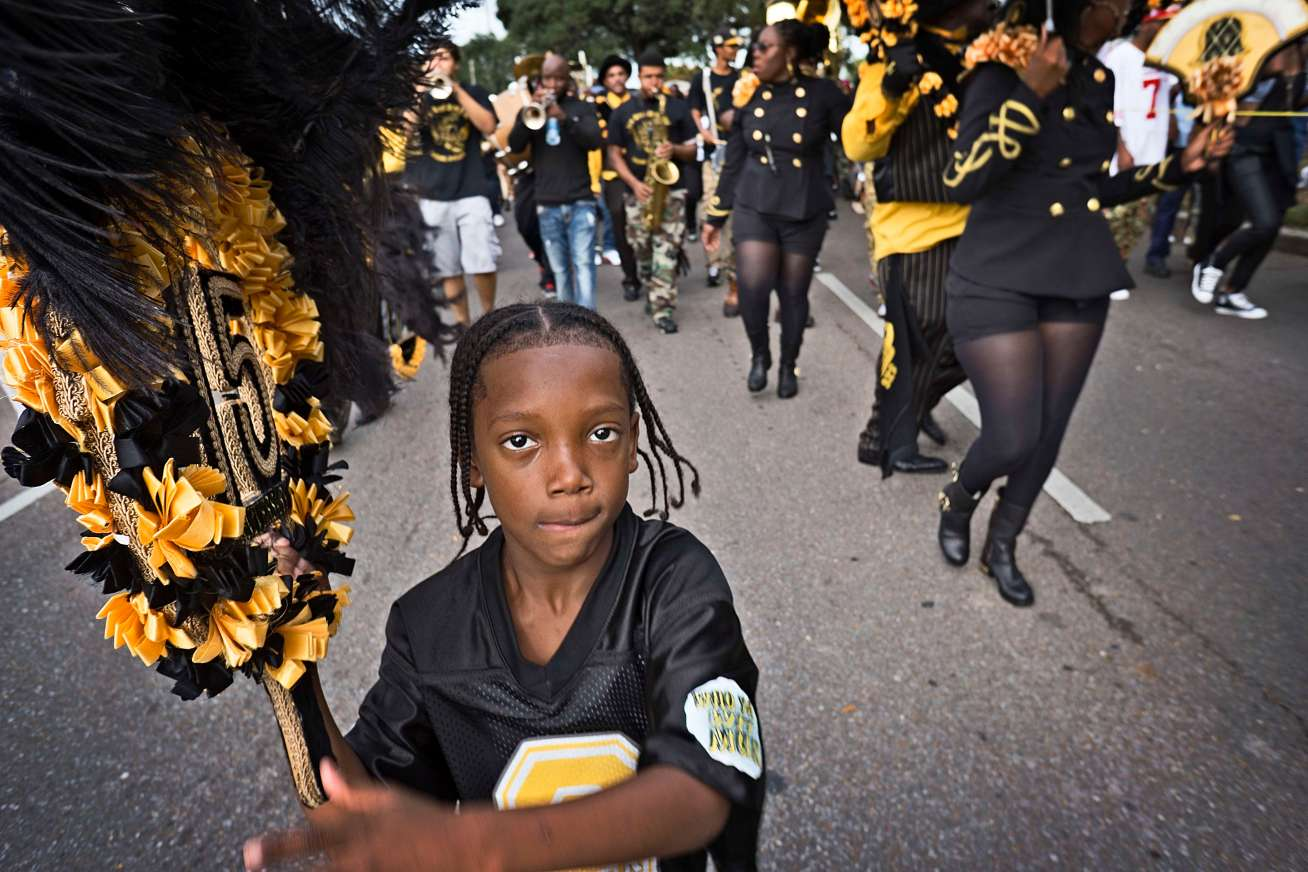 Second line paraders start young.