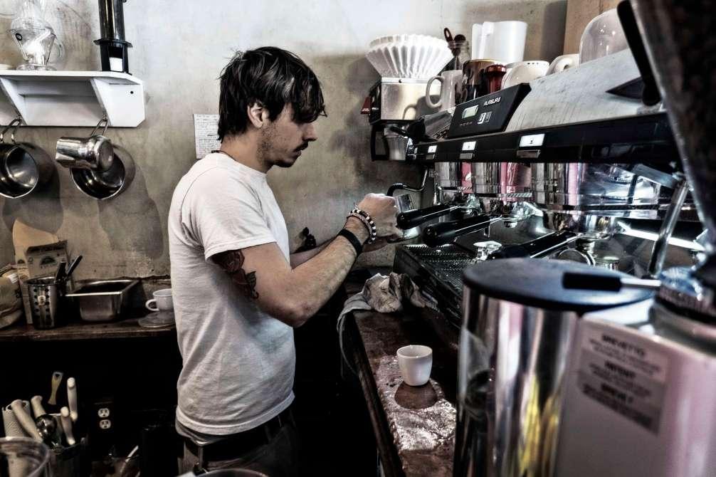 Barrista pulling my coffee.