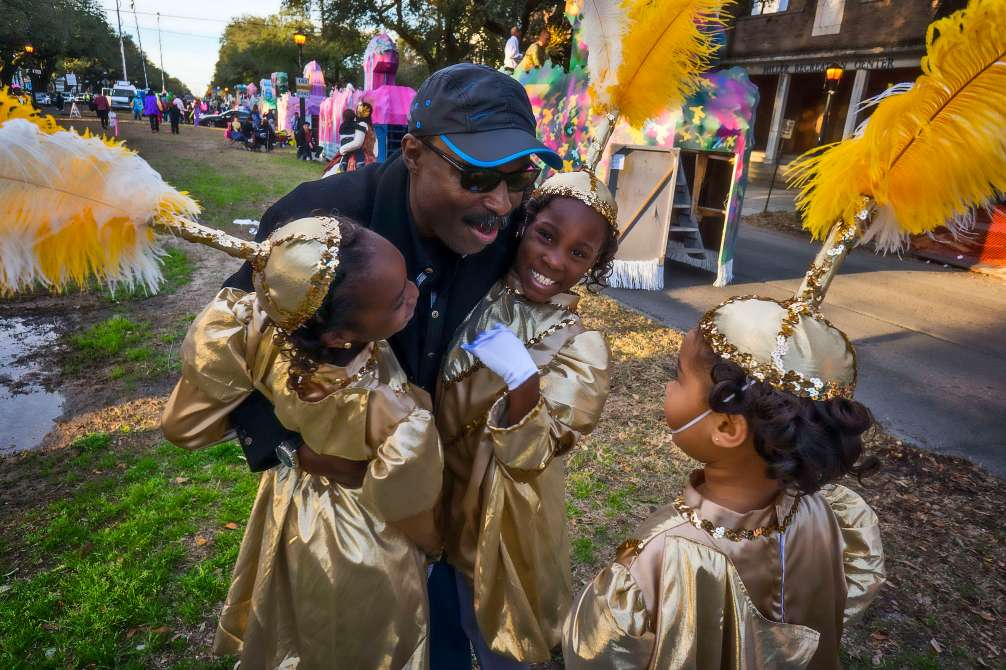 Grandpa sees his grand daughters for the first time at Mardi Gras.