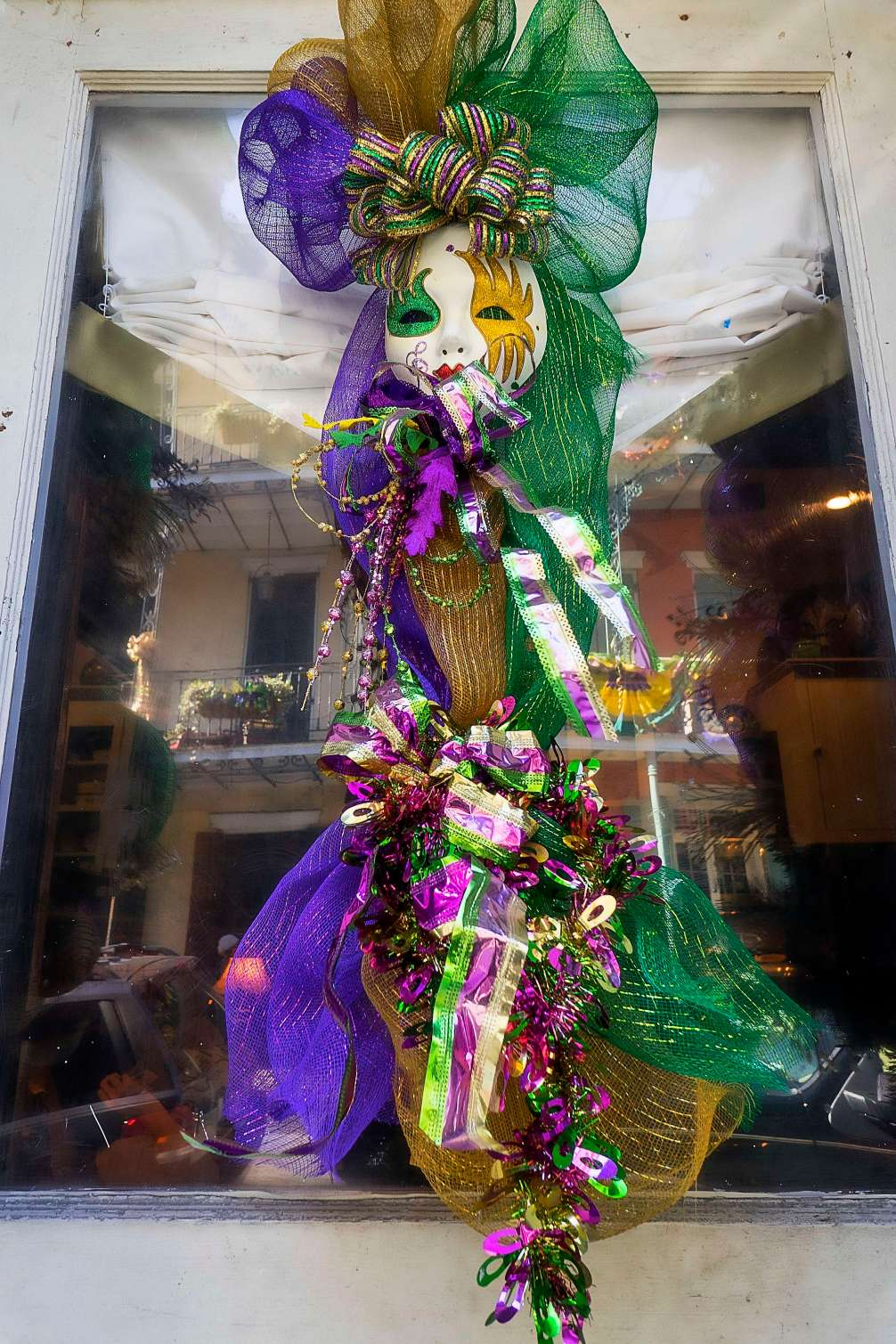 Mardi Gras decorations and reflections.