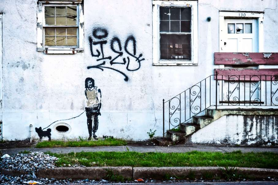 Banksy with a little help from locals taggers.