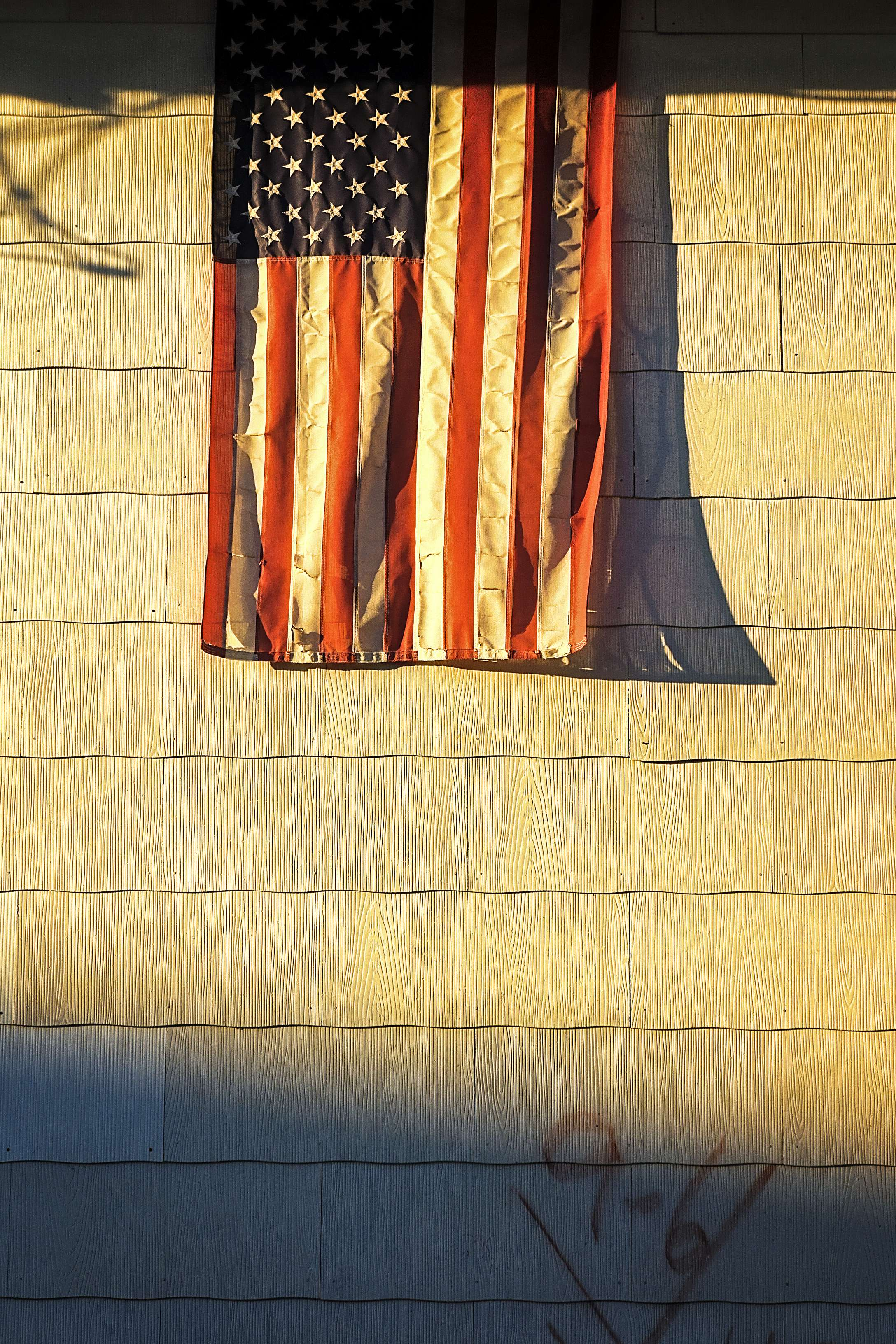 American flag and Katrina Cross.