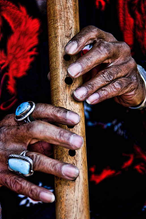 Flute player's hands.