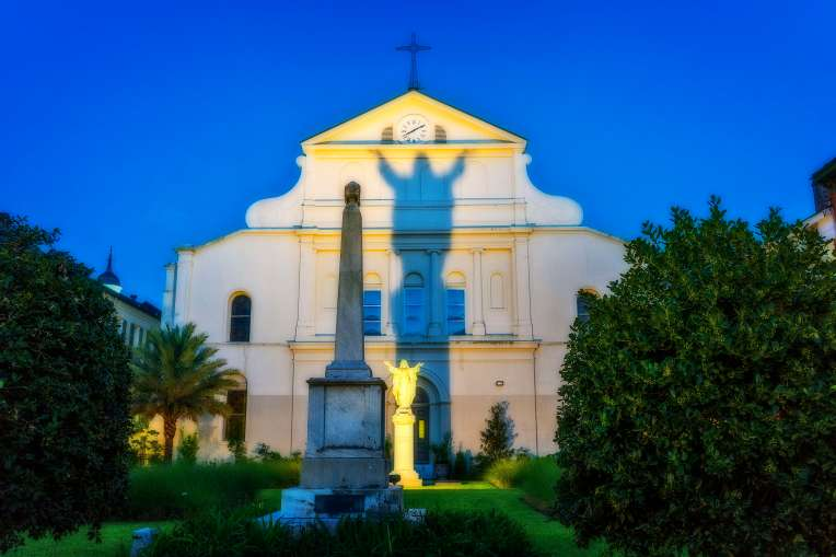 """St. Louis Cathedral, from Royal Street with the shadow known as """"Touchdown Jesus."""""""