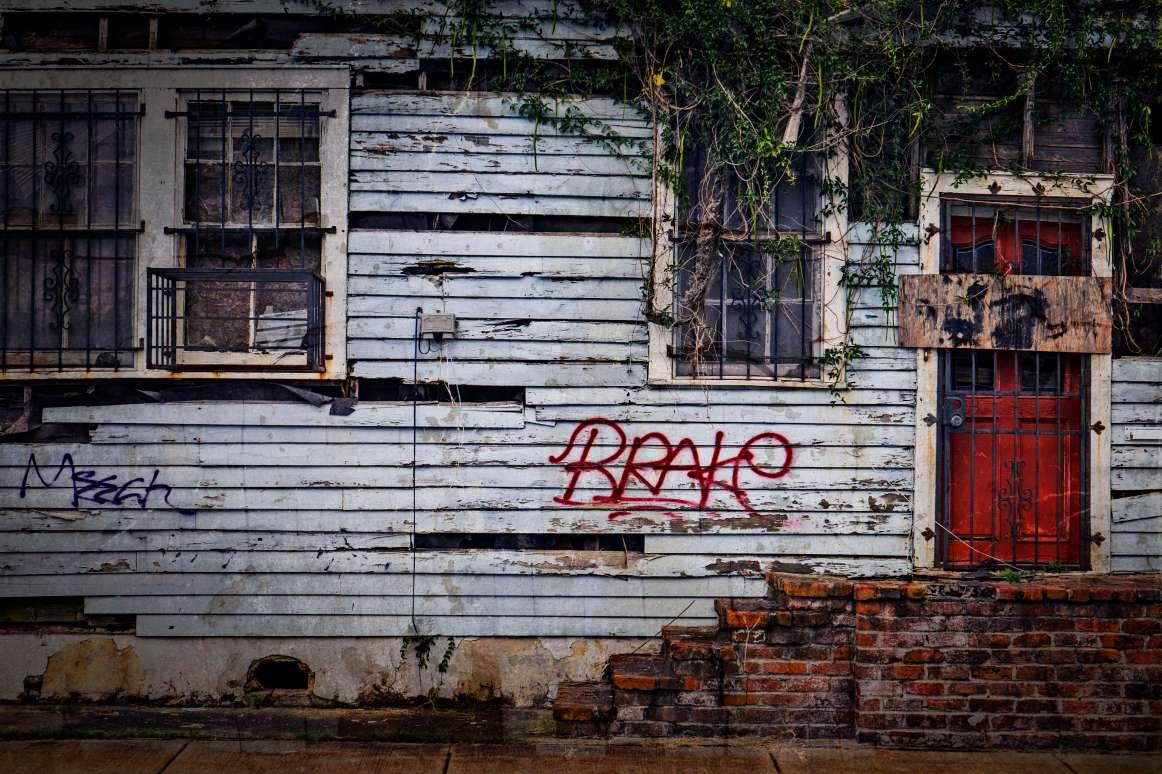 Gang Tags. Broken Houses.
