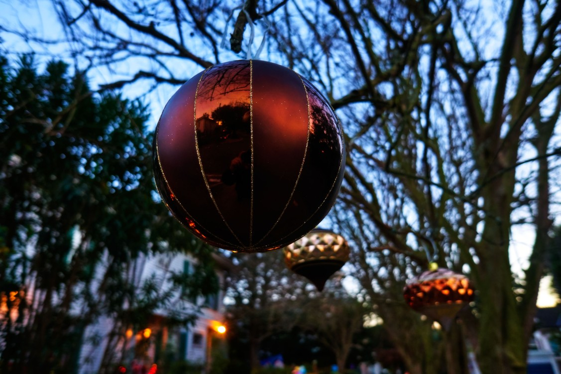 Christmas balls reflecting in the low dusk light.