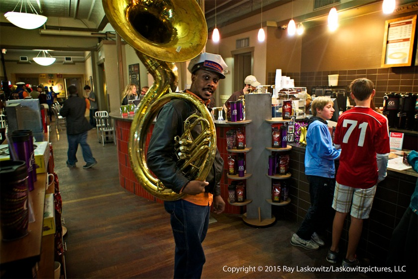 Brass band member taking a coffee break at CC's.