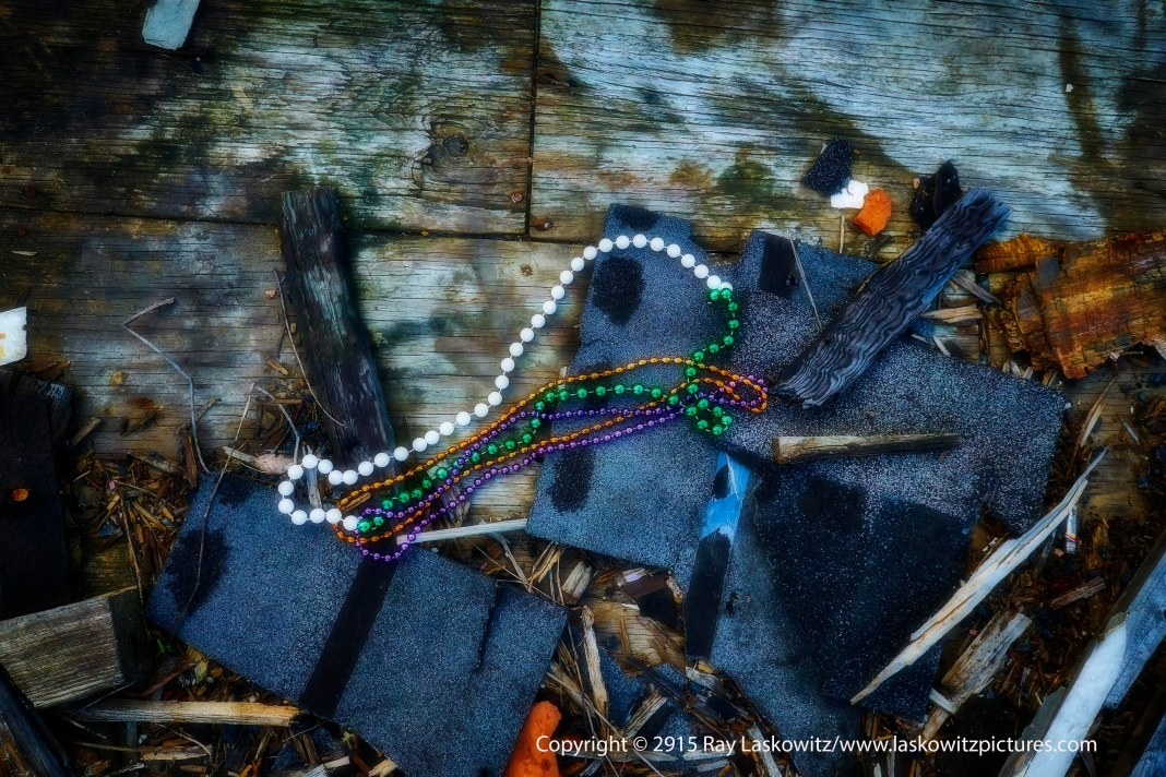 Mardi Gras beads left behind in a burned out building.
