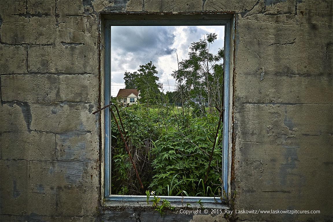 Through the empty window.