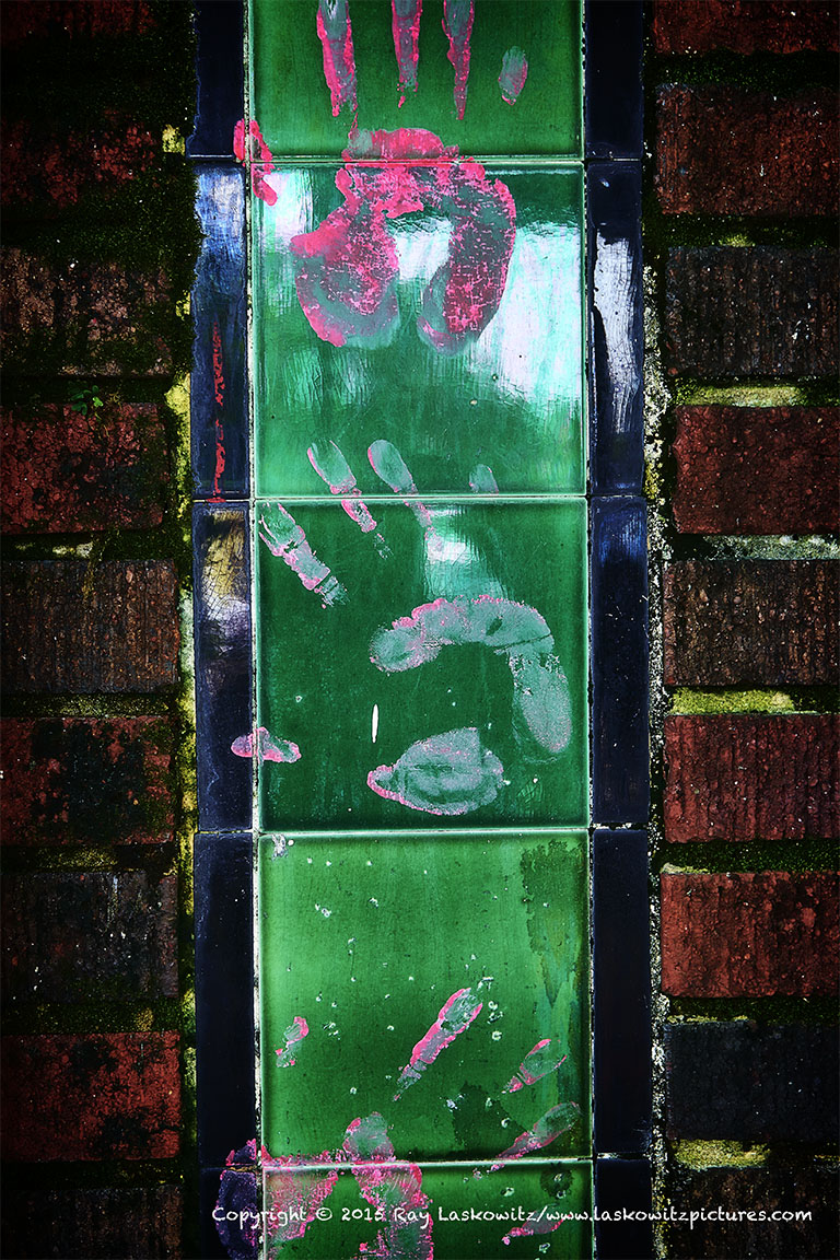 Pink handprints and green tile.
