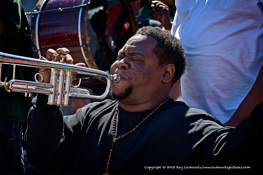 Blowing his Trumpet.