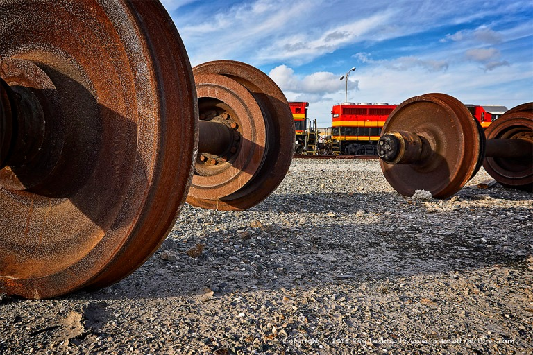 Train wheels and engines.