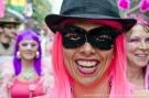 Big smile, pink hair.