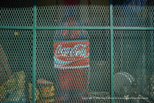 Coke behind bars.