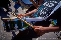 Drumming along.