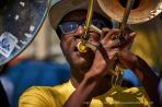 The trombone player.