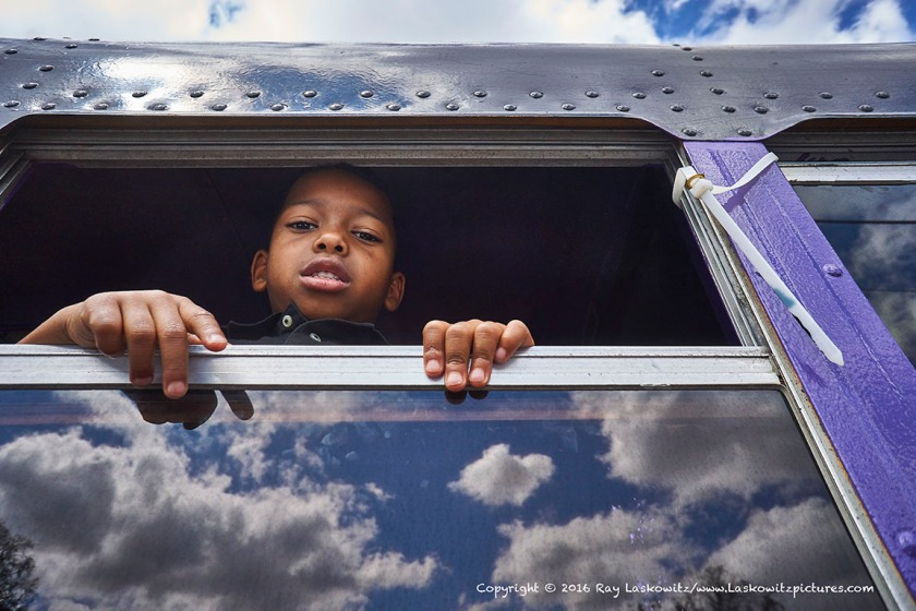 Hopes and dreams. Clouds, a young man and the bus.