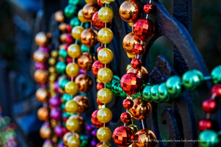 Beads on a fence.