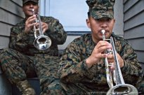 USMC trumpet players hide from the rain/